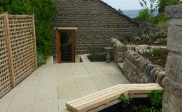 Sawn sandstone patio and coping stones with oak seating